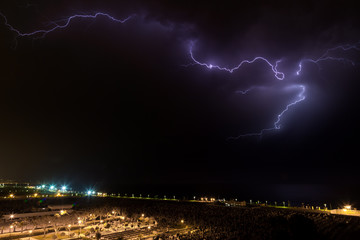 Lightning storm over the cemetery and sea of Nahariya at night