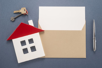 Envelope, pen, key and house