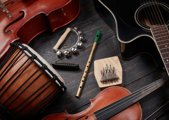 Set of musical instruments on dark wooden background