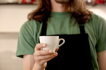 Man holding cup of coffee