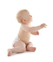 Baby sitting on white background