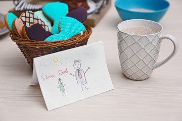 Tasty cookies with child picture on table. Happy fathers day concept