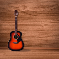 Classical guitar on wood background