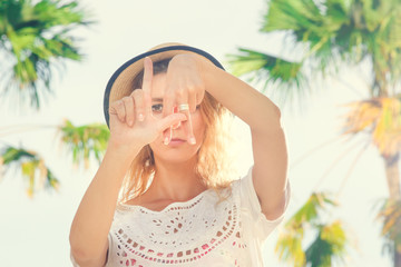 Girl showing L.A. sign with her fingers