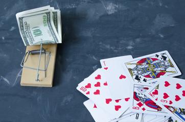 Mousetrap with money near the cards.