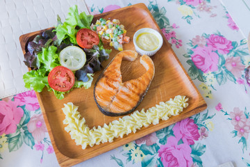 Grilled Salmon steak with salad.