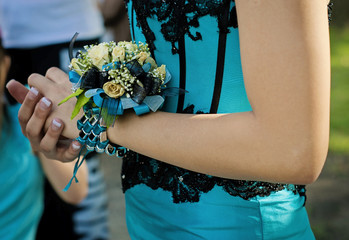 Pretty turquese and black wrist corsage worn to the prom.