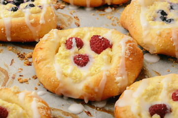 Fresh yeast buns with cheese and berries.