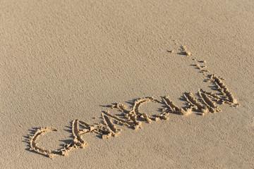 Inscription Cancun on sandy beach