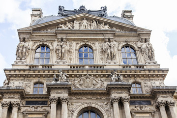 PARIS, FRANCE, on JULY 11, 2016. Architectural fragment of one of facades of the museum Louvre (fr. Musee du Louvre). This building - the ancient royal palace (Palais du Louvre)