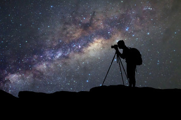 silhouette  of man photography take a photo of Milky Way galaxy