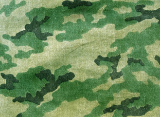 abstract weathered camouflage cloth texture.