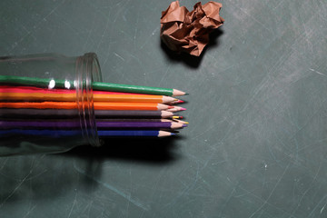 Colored pencils in glass jar