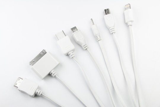 7 different cellphone charging plugs adapter from USB isolated on white background