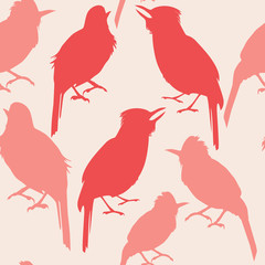 seamless pattern of pink ande red silhouettes of tropical bird on a light background