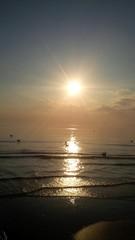 riflessi del sole sul mare