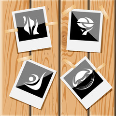 4 images of unique abstract forms. Photo frames on wooden desk.