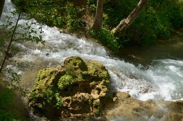 Closeup of rapids of mountain stream over rocks