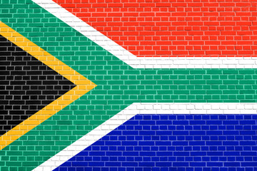 Flag of South Africa on brick wall texture background