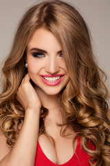 Beauty portrait of blonde woman with glamour makeup.
