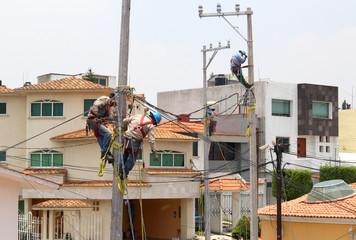 Men installing lampposts