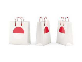 Flag of monaco on shopping bags