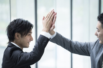 Businessmen have a high five