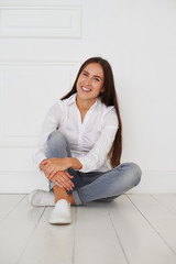 Caucasian brunette woman in casual outfit and with long hair sit