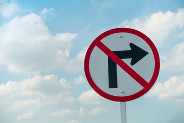Do not turn right traffic sign on skies background.