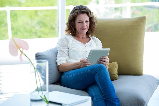 Mature woman using tablet