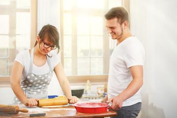 Young Couple Baking Yeast Cake