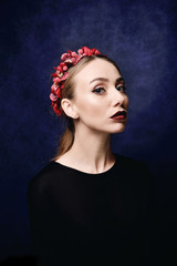 Portrait of a beautiful young girl with make-up, clean skin and hair. Flowers in her hair.