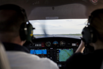 Rear view of pilots in cockpit