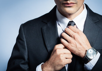 Male fashion and clothing.  Close up of man in suit.