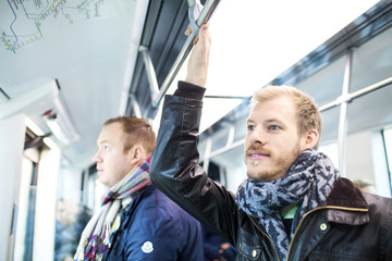 Men travelling in bus
