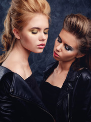 Two young girls posing together with make-up and hairstyles
