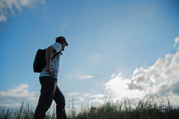 man travelling in nature with backpack