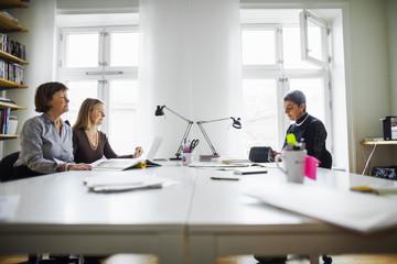 Businesswomen sitting at desk in office