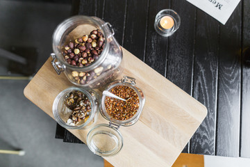 High angle view of hazel nut and chili flakes on cutting board in restaurant