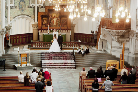High angle view of relatives attending wedding ceremony in church
