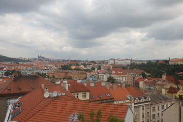 Traditional architecture of Prague. Aerial view of red roofs.