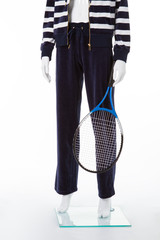 White mannequin with tennis racquet.