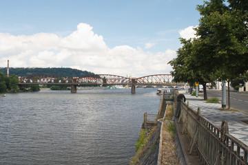 Embankment in Prague. View on the railway bridge