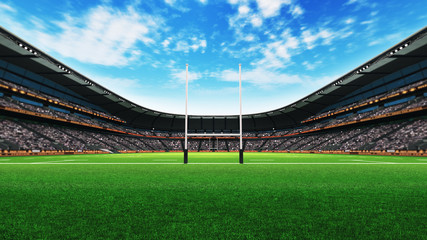 rugby stadium building with green grass at daylight