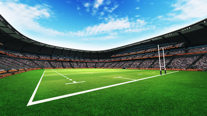 rugby stadium with fans and grass pitch at daylight