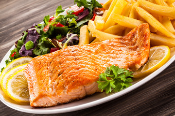 Fried salmon, chips and vegetables