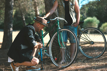 Friends in the woods with bicycles