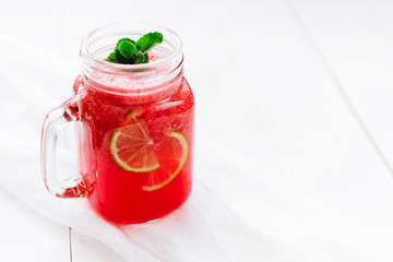 Healthy watermelon smoothie on a wood background. Freshly blended watermelon Smoothies.