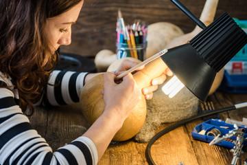 young skilled craftsman works in workshop