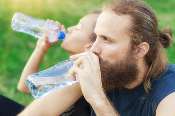 Couple drink water after exercise